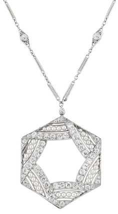 This 14K White Gold Black Enamel and Diamond Pendant