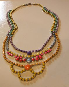 "This is 3 vintage rhinestone necklaces remade into one lovely and colorful hand painted statement piece.   $28 plus shipping of $5 US. Send email for invoicing.  Measures16"" around the neckline with the clasp closed.  The chandelier drop 3"".  Message your email for invoice.  Will use Paypal or Square, your choice."