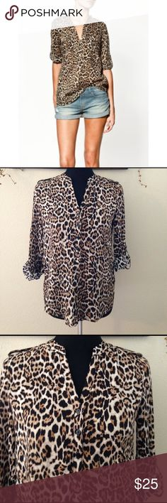 Zara Woman leopard Blouse Zara woman leopard print blouse. Buttons only part way down with a left breast pocket and has sleeves that can be worn down or buttoned up. 100% mulberry silk Zara Tops Button Down Shirts