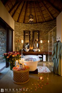A Romantic turn down service that we offer our valued guests at the lodge Safari Bathroom, Hotel Boutique, African House, Log Home Interiors, Game Lodge, Bungalow, Rustic Home Design, Thatched Roof, Relaxing Bath