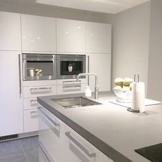 My Kitchen. We used Ikea metod cabinets and white high gloss fronts. the countertop is from concrete. We placed a quooker, oven as well as microwave and a coffee machine.