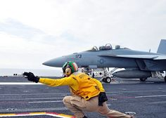 Lt. Laurie Canter signals off an F/A-18F Super Hornet assigned to the Bounty Hunters of Strike Fighter Squadron (VFA) 2 on the flight deck of the aircraft carrier USS Ronald Reagan (CVN 76).