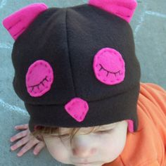 As promised, here are some photos of the fleece hat that I made for Leah's baby owl costume. You needed to see the whole picture, so I got her dressed back up in her owl costume this morning. (The Halloween night photos were all ugly with the bright flash.) I found a free pattern here …
