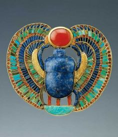 A decorative scarab discovered in King Tutankhamun's tomb. Scarabs were symbols of life, death, and eternity in Ancient Egypt. Just as dung beetles roll life-giving balls of dung across the desert, the scarab would roll the life-giving sun across the sky each day.