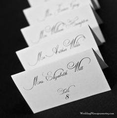 Custom Calligraphy Style Wedding Place Cards  - Escort Cards with Guest Names and Table via Etsy.