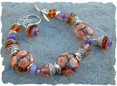 Just listed a new bracelet I made... Autumn Garden, Gorgeous Fall Lampwork Bead Bracelet. Available on our website: www.javabead.com   This would make a very special Christmas or anytime gift for yourself or for that special someone in your life.