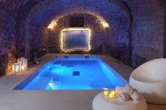 An intimate heated #indoorpool housed in an old underground wine cellar