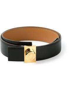 a4a8026d4fb Black leather belt from Hermès Vintage featuring a reversible gold-tone  buckle.