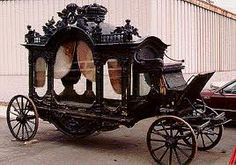 Hearse & other olde-worlde carriages.