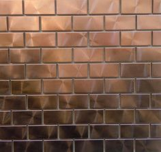 "Modern twist with 1"" x 2"" copper tiles.  Can you say bar backsplash??"
