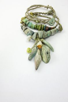 Bracelet | Grey Bird Studio Designs.   Stoneware, porcelain, wood, czech glass, hemp twine, linen thread, beach combed stone