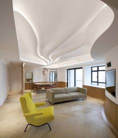 As a sort of hybrid between the baroque and relief ceilings seen in classical temple architecture the form was creates a point of reference for the dining area and chandelier light troughs full of LED striplights radiate out bathing the space in ambient light.