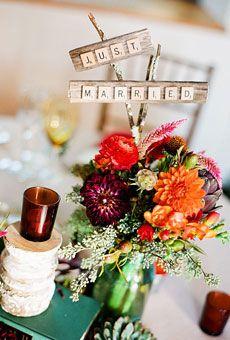 Wedding centerpiece of echinaceas, artichokes, dahlias, ranunculuses, freesias, and seeded eucalyptus by Hatch Creative Studio