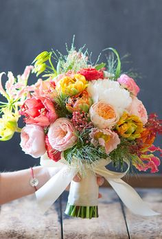 Brides.com: How Much Do Wedding Bouquets Really Cost?. Bouquet of amaryllises, explosion grasses, garden roses, tulips, gloriosas, ranunculuses, Christmas bush, peonies, poppies, and peppers, $275, Tulipina Floral Design/Kiana Underwood