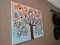 This is so pretty!  The buttons are fun.  We could paint the tree, then let the kids glue the buttons, or little wood pieces that they decorate?  And maybe a quote/saying that involves a tree or growing?