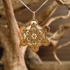 """Metatron Cube Gold - Cross culture, sacred geometry symbol for inner peace and spirituality. The Metatron Cube A known harmonious structure from sacred geometry named after the Archangel Metatron.  Metatron appears in Jewish tradition, Christian tradition, and in some aspects of Islam.  Metatron is in charge of all of creation and is considered an Arch angel as well as a judge.   The structure of Metatron cube arises from the structure of the """"Fruit of Life"""" and found around the world …"""