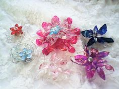 Flower brooches from plastic bottle flowers. Part of the line I am designing for spring  <3 Sheil
