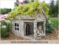 The new wooden house planter serves as a spot for fairies to hang out, as well as a planter for your garden!