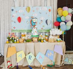 As a child, the sky is the limit of dreams and possibilities.  So, it's only natural that little Aram's first birthday be celebrated in sky high style.  Complete with a colorful hot air balloon them and a delicious dessert table, this is one little guy ready to take flight! Photography: Paper Ban Photography // Paper …