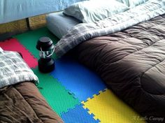 Foam floor tiles used inside a tent are perfect cushioning for sleeping and are lightweight.