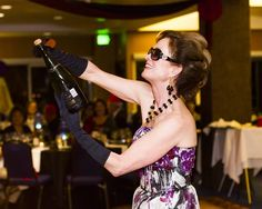 Master Sommelier Catherine Fallis sabers a bottle of Moet Imperiale for the Alain Pinel group. Champagne, Celebrities, Group, Bottle, Women, Fashion, Moda, Celebs, Fashion Styles