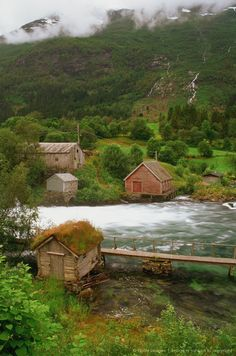 Log cabins on both sides of the river, Nordfjord, Olden, Norway