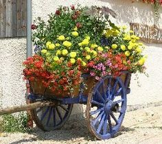 An old cart decorated with flowers