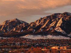 Beautiful photo of sunrise over the snowy flatirons