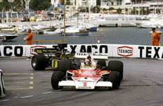 Emerson Fittipaldi (McLaren-Ford M23) & Ronnie Peterson (Lotus-Ford 72E), 1975 Monaco GP, Monte Carlo