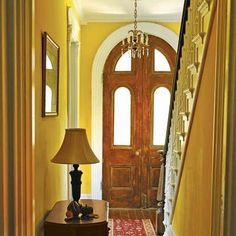 Mahogany doors and heart-pine floors add warmth to a regal entryway, especially after being sanded and refinished.