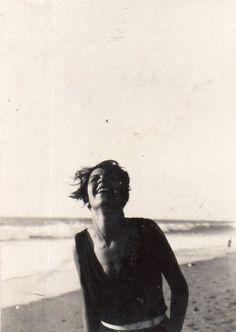 Woman laughing, circa 1920s.