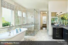Love the huge glass shower and beautiful bathtub!