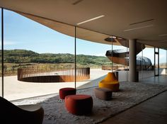 Cantin Antinori by Archea Associatii, San Casciano val di Pesa, Italy. Located in the unique chianti landscape halfway between the scenic florence and siena amongst the vast fields of vineyards, the 'cantina antinori' winery  by italian practice archea associati explores the relationship between man, a product, the site and the process of manufacture in their most essential forms.