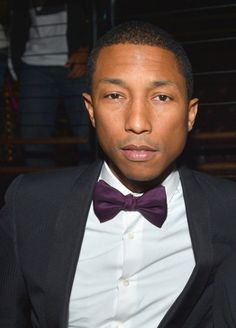 Here is Pharell Williams in 2013. Age forty. Forty! Pharrell doesn't age. Click through for photographic proof.