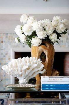 coastal coffee table arrangement  There are so many great faux corals out there