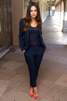 Mila Kunis in a midnight blue trouser suit and top at a press conference in LA for new movie, Oz the Great and Powerful. She completed her look with Christian Louboutin's pink 'Pivichic' heels. Lush.
