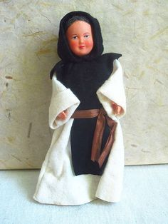 Vintage French celluloid Monk doll, with an all-felt outfit with a cream robe and black hood, a brown ribbon as a belt and white satin trousers