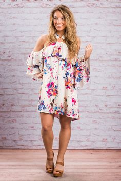 """Record Beauty Dress, Magenta""This dress sets the record for beauty! It's floral print and unique neckline are stunning! #newarrivals #shopthemint"
