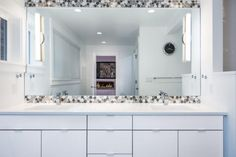 bathroom with accent tile around mirror