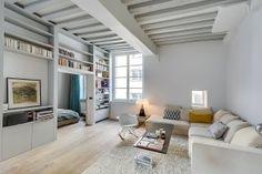 French designer Tatiana Nicol transforms this Parisian apartment into a chic, cozy home.