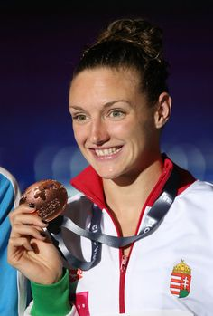 Bronze medal winner Katinka Hosszu of Hungary celebrates on the podium after the Swimming Women's Butterfly 200m Final on day thirteen of the 15th FINA World Championships at Palau Sant Jordi on August 1, 2013 in Barcelona, Spain.