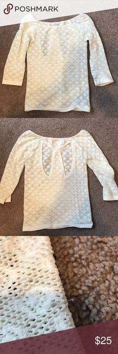 Free People Lace Top White Lacey top with back detail and 3/4 sleeves. Quite a big stretchy and a snug fit. Size medium! Only noticeable flaw is one snag in the lace and a small grayish spot on the neck (see photos). Only worn about 5 times. Free People Tops Blouses
