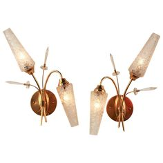 Pair of Elegant Mid-Century Modern Wall Sconces | From a unique collection of antique and modern wall lights and sconces at http://www.1stdibs.com/furniture/lighting/sconces-wall-lights/