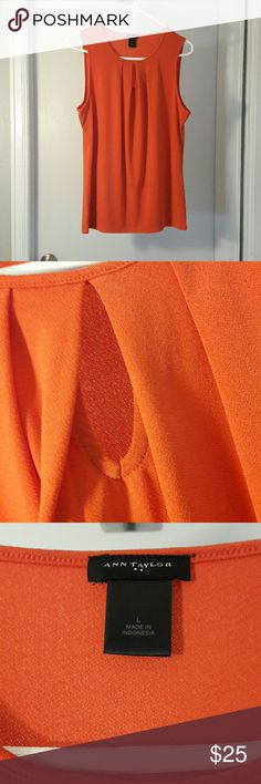 NWOT Orange Ann Taylor Tank Size Large Nwot Orange Ann Taylor Tank Size Large 25 inches long Keyhole Detailing in the front Made out of nice material Ann Taylor Tops Tank Tops