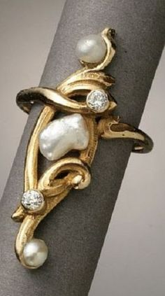 An Art Nouveau Yellow-Gold, Biwa Pearl and Diamond Ring, Circa 1890. Set with three biwa pearls measuring 3.30 to 5.60 mm and two old mine-cut diamonds. #ArtNouveau #ring