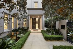 Beautifully maintained landscaping guides you to the front entrance of this home.