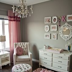 The deep grey walls add a modern twist on the traditional shabby chic nursery