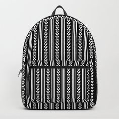 """Designing our premium Backpacks is a meticulous process, as Artists have to lay out their artwork on each component. One size fits all men and women, with heavy-duty construction that's able to handle the heavy lifting for all your school and travel needs.     - Standard unisex size: 17.75"""" (H) x 12.25"""" (W) x 5.75"""" (D)   - Crafted with durable spun poly fabric for high print quality   - Interior pocket fits up to 15"""" laptop   - Padded nylon back... Backpacks For Sale, D Craft, Daisy Chain, Designer Backpacks, Black Backpack, One Size Fits All, Laptop, Handle, Construction"""