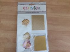 Crafty Bitz pk DC117 gold papers shapes  etc by TheBargainStoreUK