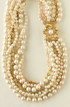 COMPLETED: Took this picture and my old  pearls...and completed my next DIY project.  I have lots of old pearl necklaces in differences sizes and shades of white/off white, etc..found a pretty jewelry clip that will hold them all together...a great new twist for some old pearls.